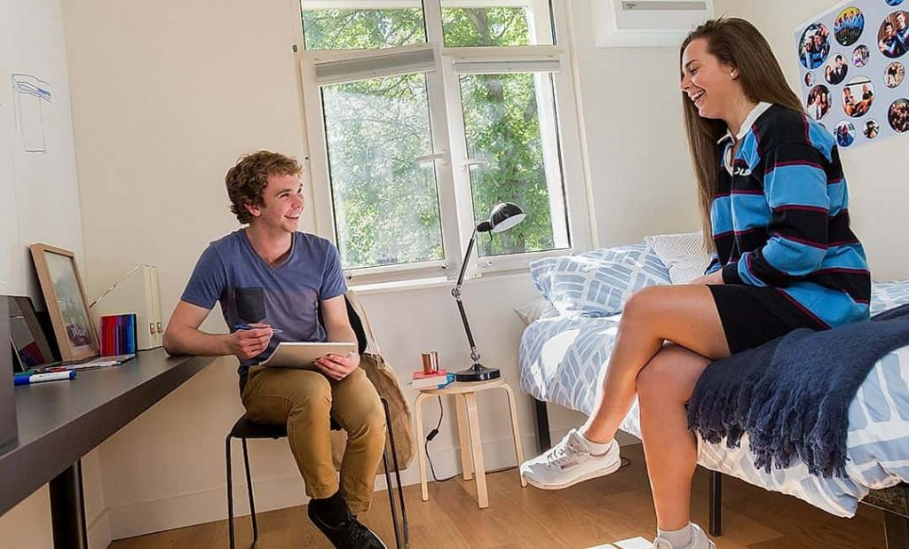 students chatting in campus room